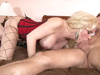 Blonde with massive boobs satisfies dudes sexual needs and then gets cum sprayed