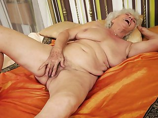 Mature with round booty stripping down to her birthday suit and plays with herself