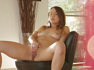 Brunette finds herself horny as hell and takes sex toy in her pussy hole