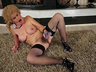 Mature with gigantic breasts is too hot to stop fingering her bush