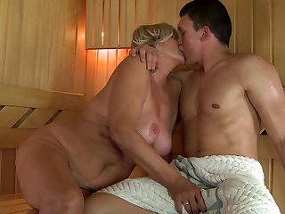 Mature with big breasts can't resist the temptation to take hard snake in her mouth